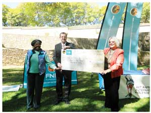 AVP Namibia Chairperson Rosa Namises, trustee of the FNB Foundation Ian Leyemaar and Chairperson of the Association for Alternatives to Violence Project Namibia, Helen Vale at the handover. (Photograph by Melba Chipepo).