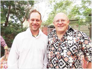 Mr Bible, the Reverend Barnie van der Walt (right) and young admirer, Ian Petherbridge share joyful memories at a Windhoek garden party. The Reverend van der Walt tied the knot between Petherbridge and his bride at the couple's wedding in Swakopmund.