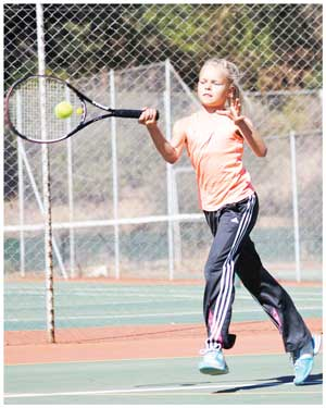 Young Stephany Schulz claimed the bronze medal in the Beginner category of the Kia Tennis Tournament. (photograph contributed)