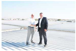 O&L Energy MD, Bernd Walbaum (left) with NBL MD, Wessie van der Westhuizen on the NBL rooftop where the solar panels will be mounted.