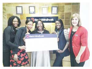 Maria Nangula Akudhenga, with staff members of the Bank Windhoek Oshakati-North branch after receiving her N$10,000 prize. Seen here are Eline Haimbili, Loini Nghuulikwa, Ndemutumbaleka Hauholo and Lilly Steenkamp, Officer-in-Charge at the branch