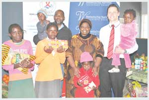 "The children of ""Hope Initiative Southern Africa –Namibia"" (HISA) received N$24,000 for their scholarship programme and N$10,000 for clothing, food, toys and various other items from Welwitschia Nammic Insurance Brokers. Director, John Sola, and Programme Director Patricia Sola joined Riaan Vermeulen, Managing Director of Welwitschia at the official presentation of the donation."