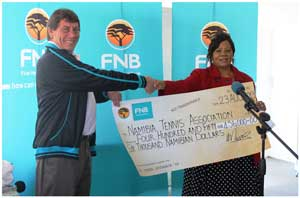 Bob Mould, President of the Namibia Tennis Association and Clara Bohitile, FNB Foundation member shake hands on a great deal.