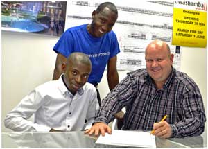 Seated on the left is Laimo Lukas, a Polytechnic student in Property Studies with Desmond van Jaarsveld, the Managing Director of Safland. Standing is Vaino Johannes, also a property student at the Poly.