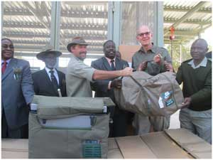 Hon. Lawrence Sampofu, Governor of the Caprivi Region, Chief Tembwe Mayuni of the Mashi Traditional Authority, Minister of Environment and Tourism, Hon. Uahekua Herunga and His Excellency Onno Huckmann, Ambassador of the Federal Republic of Germany, handing over equipment to the conservancies and the Ministry of Environment and Tourism staff. The equipment  will be used during anti-poaching patrols.(Photograph by Hilma Hashange)