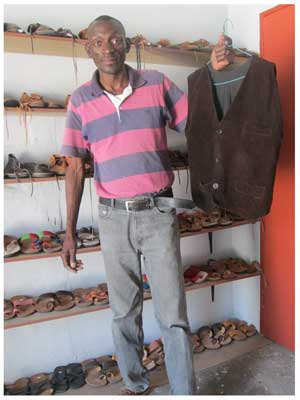 Salatiel Hatutale of Liiza Shoe Maker with a few of his leather made products. (Photograph by Hilma Hashange)