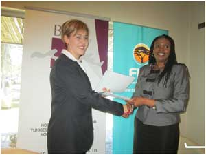 Helga Busing-Volschenk (left), Chief Operations Officer of the Business School of Excellence in Namibia and Ester Kali, Executive: Retail and Business Banking at FNB during the signing of the  agreement (Photograph by Hilma Hashange)