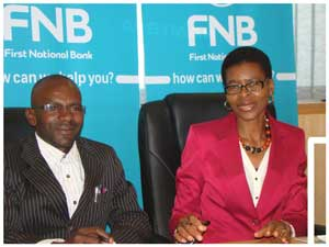 Lawrence Ihuhua, Secretary General of the Namibia Bank Workers Union and Head of HR at FNB Namibia with Florentia Amuenje at the signing ceremony of the wage agreement between FNB and the Union at the Ministry of Labour and Social Services earlier this week.