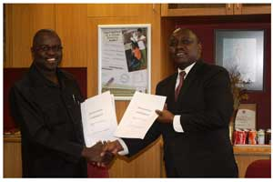 Peter Nevonga NAPWU Secretary General and SSC acting EO Mr. David Keendjele shake hands.