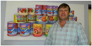 Richard Ahrens, General Manager at United Fishing Enterprises with a display of the labels that are so popular with consumers.
