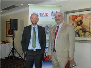 Caption: Mark Robertson Lead Author, NGO Commercialization Assessment and Barry Primm Mission Director,USAID​/Namibia. (Photograph by Melba Chipepo).