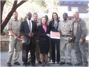 Director of Tourism Sam Shikongo, British High Commissioner Marianne Young with the graduates J.G Gericke, Edgar Lister Naude, Mafeleleso Felix Mbambo, Muyunda Namangolwa Lister and trainer Johan Fourie at the graduation ceremony. (Photograph by Melba Chipepo).