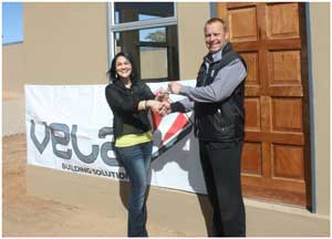 Ecstatic Win a House winner, Yolandie van Wyk was overjoyed when she heard she has won the Vela House in the Wispeco's competition run during last year's Windhoek Show. Louis van den Berg, the MD of Wispeco did the honours.