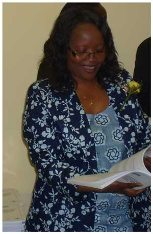 """Deputy Minister of Education, Hon Silvia Makgone holding the first-ever science journal in Namibia titled """"The International Science and Technology Journal of Namibia (ISTJN)"""" (Photograph by Daniel Kavishe)"""