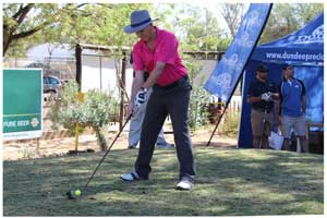 All eyes on the ball- DPMT Financial Manager Gary Spinas prepares to send the ball sailing toward Hole 1.