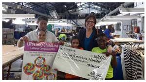 Gustav Peters (left) of Nakara and Jane Shityuwete of LifeLine/ChildLine with Shana, Tamzyn and Patience of Uitani ChildLine Radio. Nakara helps Childline by providing them with a lollipop kiosk at their annual winter sale, and by donating the proceeds of the Fruehschoppen to the charity.