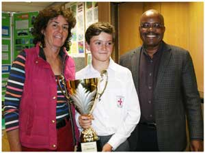 Oliver Diggle (middle) from St. Georges is the overall primary school winner in the Khomas Regional Science, Mathematics and Technology Fair. He was presented with his trophy by Debmarine CEO, Otto Shikongo and supported by his proud mother, Mrs Diggle.