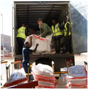 Jaco van Zyl of Agra assisted by the Customs and Excise crew at Hosea Kutako International Airport loading a consignment of more than 55,000 swakara pelts for auction in Denmark next week.