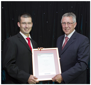 Ryan Geyser, Senior Manager: Product/Channel Development and E-Channel Processing at Bank Windhoek, received the MD's Leadership award for management staff. He is pictured receiving the award from Christo de Vries, Managing Director of Bank Windhoek.