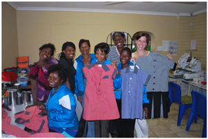 Jennieke Bolier (right), Project Manager of Anusa, with some of the women employed at Anusa. In the back row f.l.t.r., are Paulina Garises, Philadelphia Ivy Tsaoës, Dina Garises and Sara Pienaar. In the front row, f.l.t.r., are Eveline Andreas (seated), Jeanetha Eichas, and Lydia Kahone.