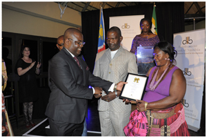 Fresh n Bake Bakery and Market received the award for Best SME. The Okuryangava bakery provides employment for 120 people. Above: Mrs Alina Naidyala receives the winner's certificate from Mr I-Ben Nashandi with her business partner, Mr Moses Josef looking on.