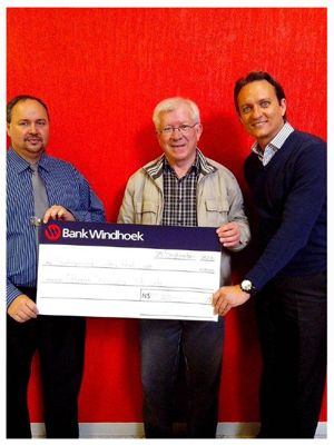 Paul Schrader (left), Branch Manager of Swakopmund Branch and Alex Visser (right), Manager: Sales at Swakopmund Branch, handed over the cheque to Hennie Bester (centre), Treasurer of the Swakopmund Lions Club.