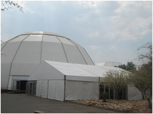 The 3200 square metre dome will host around 1700 delegates while smaller break-away session will take place in the smaller tent in the foreground.(Photograph by Hilma Hashange)