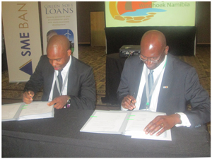 CEO of the Environmental Investment Fund of Namibia, Benedict Libanda and CEO of the SME Bank, Tawanda Mumvuma signing for the green loans scheme. (Photograph by Hilmah Hashange)