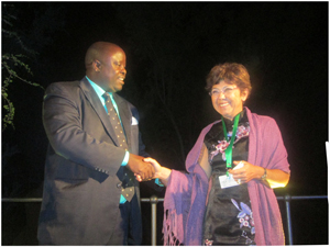 Minister of Environment and Tourism and President of the eleventh Conference of Parties (COP11) Hon. Uahekua Herunga congratulates the newley appointed United Nations Convention to Combat Desertification (UNCCD) Executive Secretary, Monique Barbut. (Photograph by Hilmah Hashange)