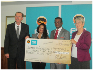 Ian Leyenaar, CEO of FNB, Smita Francis, researcher and lecturer at Polytechnic of Namibia, Prof. Tjama Tjivikua, Rector of the Polytechnic of Namibia and Chairperson of the FNB Foundation, Jane Katjavivi at the handover ceremony of N$72 000 to the Women in Engineering's Solar Lamp Project.