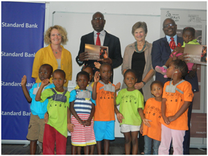 From the left are the photographer of the CLaSH calender ,Mechthild Merdes, Head of Marketing at Standard Bank, Thaddeus Maswahu, Director of CLaSH, Heide Beinhauer, Head of Risk Compliance at Standard Bank, Ehrenfried Meroro with CLaSH children at the launch of the new calendar. (Photograph by Melba Chipepo).