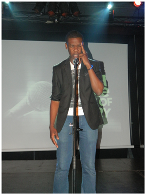 First time Spoken Word artist Ashwin Mberi had the crowd begging for more. (Photograph by Melba Chipepo)