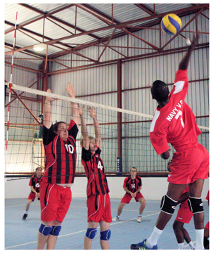 Some of the action that can be expected at this weekend's games on Saturday at the DTS Hall in Olympia. DTS is seen here playing against Navy Volleyball Club in a previous game.