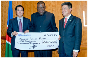 Prime Minister, the Right Honourable Dr Hage Geingob, flanked by the Chairman of Swakop Uranium's Board of Directors, Mr Zhiping Yu and the Ambassador of China Mr Xin Shunkang at a ceremony held this week in Windhoek. Swakop Uranium contributed N$100,000 to the Drought Relief fund.
