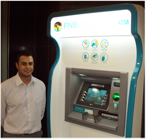 Brandon Brock, Manager FNB ATM, at one of the first brand-new automatic tellers.