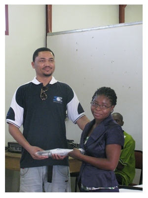 Earl Goliath, an employee of Skorpion Zinc, handed a donation of white canes over to Monica Nangolo, southern regional coordinator of the Namibian Federation of the Visually Impaired (NFVI) during the commemoration of White Canes Day on 17 October. (Photograph by Clemencia Jacobs)