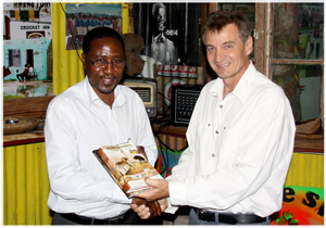 Stamps & Stories (Volume 2), a book telling Namibian stories through stamps. Shaking hands are NamPost CEO Festus Hangula and Gondwana MD Mannfred Goldbeck. (Photo: Gondwana Collection)