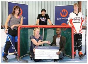 Bank Windhoek has sponsored N$20 000 to NIIHA to host the National Inline Hockey Championship Tournament on 1 and 2 November 2013 at the SFC Rink in Swakopmund. Receiving the cheque from Toivo Mvula, Communication Practitioner at Bank Windhoek, is Gudrun Denker, President of NIIHA with some of the hockey players.