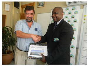 Fernando Hopes, MD of Technonam Roads and Bridges with Conrad Lutombi at the signing of the contract for work to be done on the three bridges between Mariental and Rehoboth on Tuesday. (Photograph by Lorato Khobetsi)