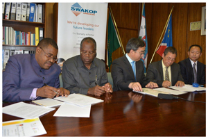 Signing the Memorandum, are from the left, UNAM's Pro Vice Chancellor and Vice Chancellor, Dr Boniface Mutumba and Professor Lazarus Hangula, with Swakop Uranium's CEO, Mr Zheng Keping, its Human Resources Director, Percy McCallum and Senior Vice-President for Human Resources and Business Support, Dr Peng Xinjian.