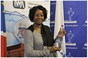 Windhoek's Mayor Agnes Kafula holds the water from Windhoek Goreangab Operating Company (WINGOC) which IWA conference delegates will Tour during the IWA Water Reuse Conference later this month.