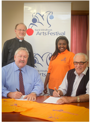 Finalising the sponsorship for the popular Swakopmund Musikwoche are Riaan van Rooyen of Bank Windhoek (seated left) and Peter Steinkopff, chairman of the Swakopmunder Musikwoche. Standing are Pastor Klaus Tietz (Board member representing the patron DELK) and Ailly Namupala (Assistant to the Organisational Director of the Swakopmunder Musikwoche).
