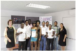 General Manager of the Namibian Business Innnovationi Centre, Dorothea Westhofen-Kunz, standing left, with Asnath Kambunga, the RLabs Country Coordinator and Rene Parker, the RLabs Director, congratulating their students on the successful completion of a training course in Social Media.