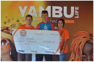 1st Place winner in mens 50 km challenge, Heiko Redecker receives his cheque from representatives of Trustco.