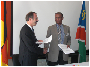 Alois Schneider (left) of the German Federal Ministry for Economic Cooperation and Development  and Willem Goeiemann of the National Planning Commission, after the meeting where Germany's development aid to Namibia has been finalised.