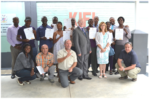 The Deputy Minister of Fisheries and Marine Resources, Hon Dr Samuel Ankama (standing centre right), the Spanish Ambassador, Her Excellency Mrs Carmen Diez (fifth from right), and officials from the fisheries ministry, and the inland fisheries institute, who accompanied the ambassador on her field trip.