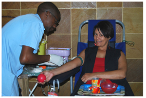 Caroline Mouton of Bank Windhoek donating blood during the fifth and last Bank Windhoek Blood Donation Clinic for 2013.