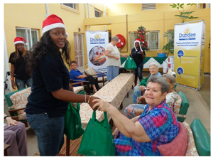 Each resident in Maroela Park Retirement Home in Tsumeb received a small gift from Dundee Precious Metals. Here, Charmel Handura brings Christmas joy on behalf of the smelter operator.