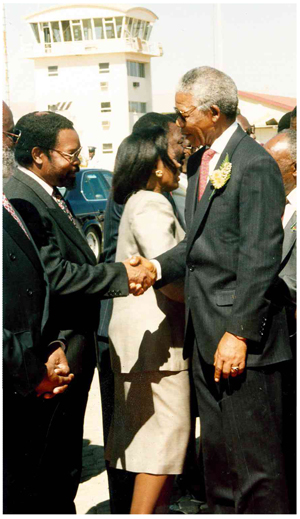 Hidipo Hamutenya welcomes the late Nelson Mandela at Eros Airport on his last state visit to Namibia.