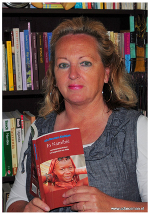 Well-known Dutch travel books author, Ada Rosman Kleinjan, with one of her Namibian travel books originating from her previous visits to the country.